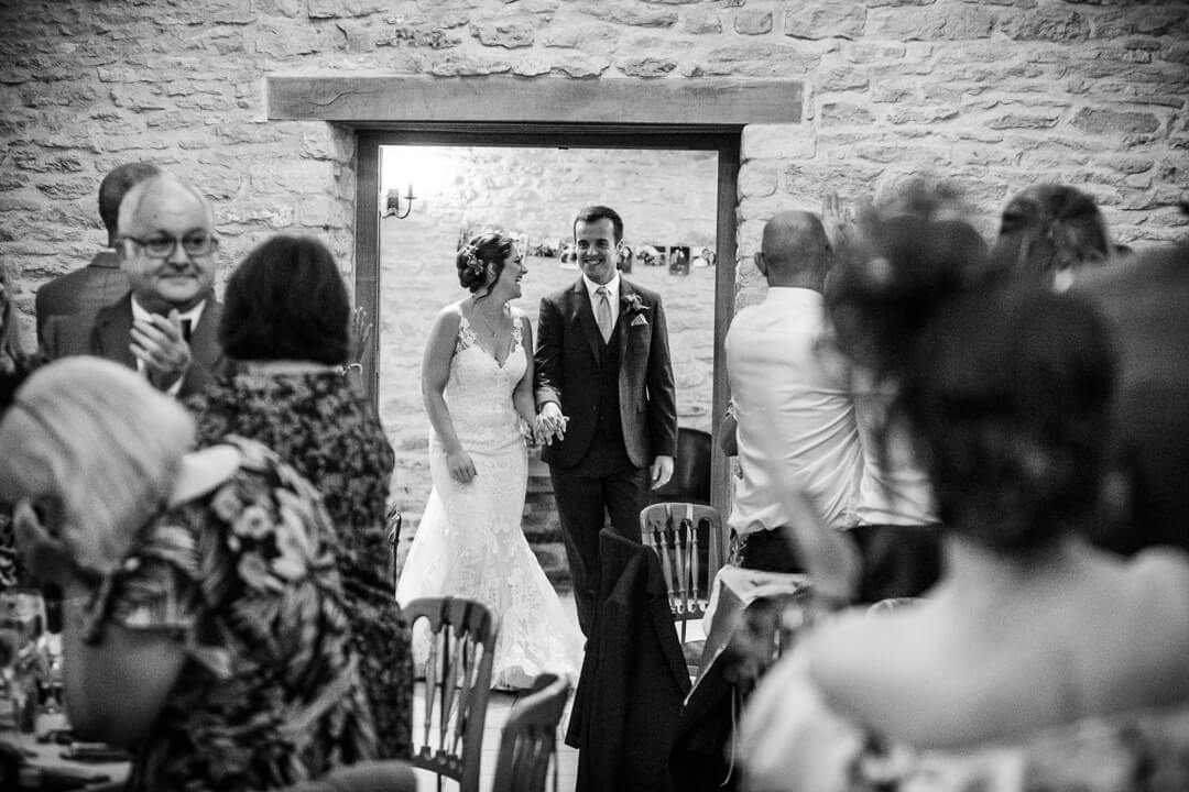 Bride and groom entering dining room at wedding reception