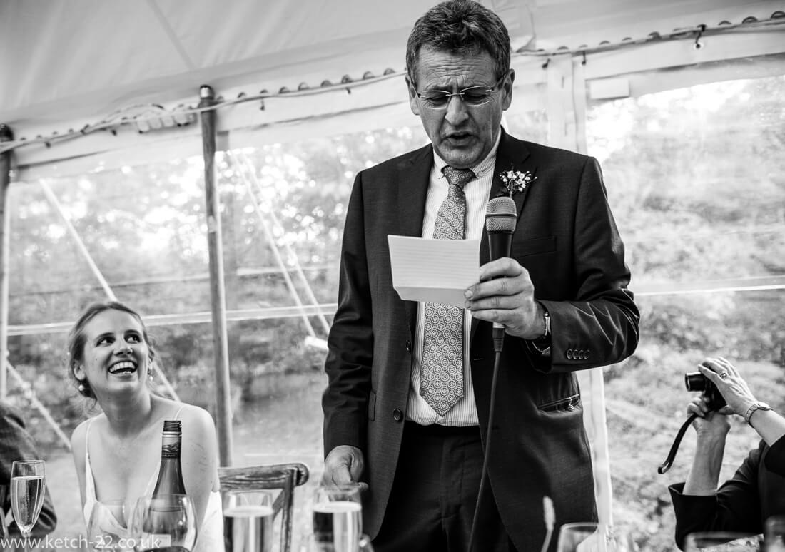 Father reading from notes at wedding speech