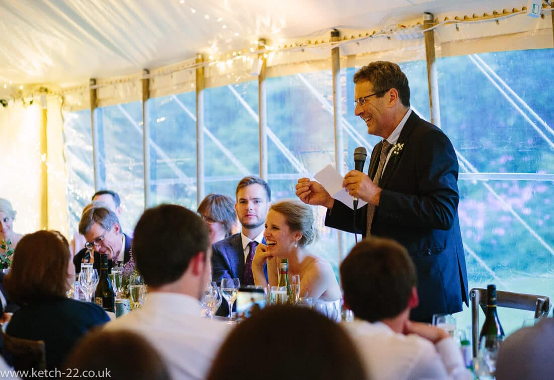 Father of bride making speech at marquee wedding
