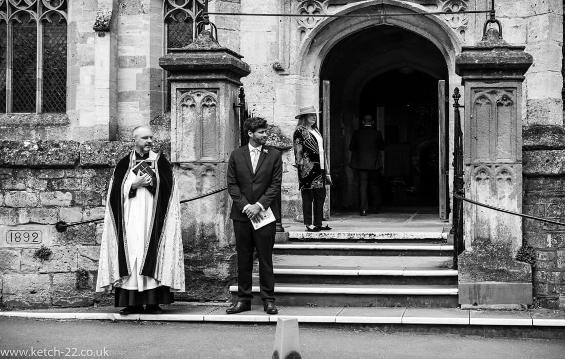 Grooms men waiting for bride outside Winchcombe church