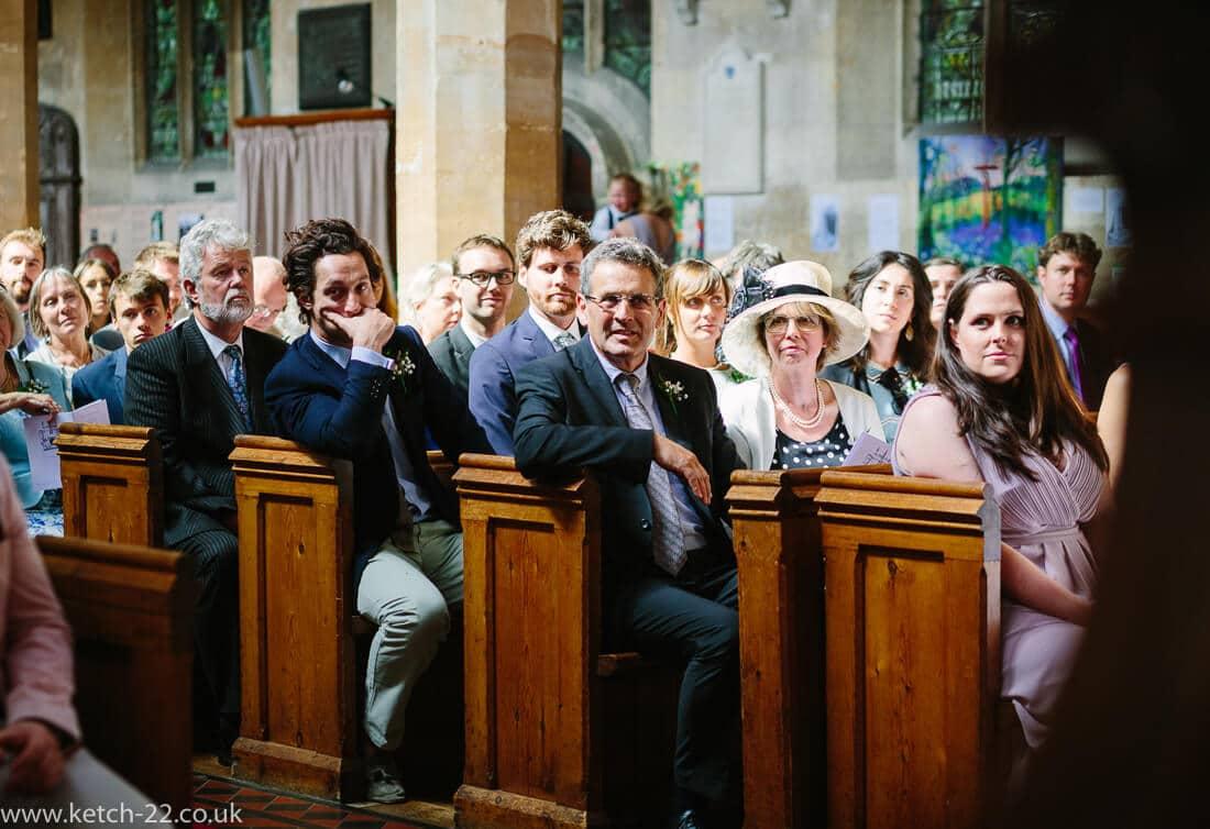 Wedding guests listen to vicar