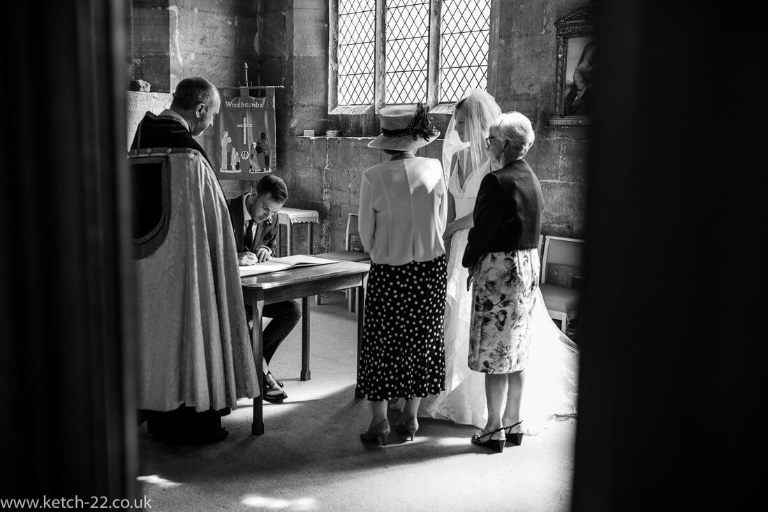 Groom signing the wedding registrar