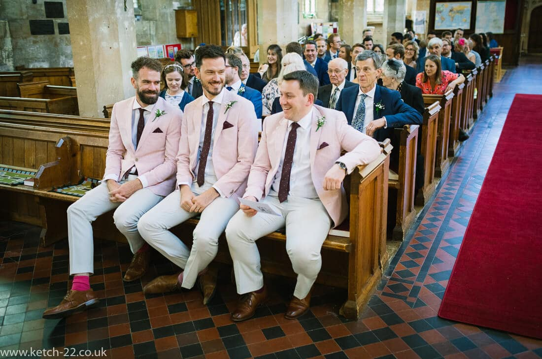 Groomsmen in pink at church wedding