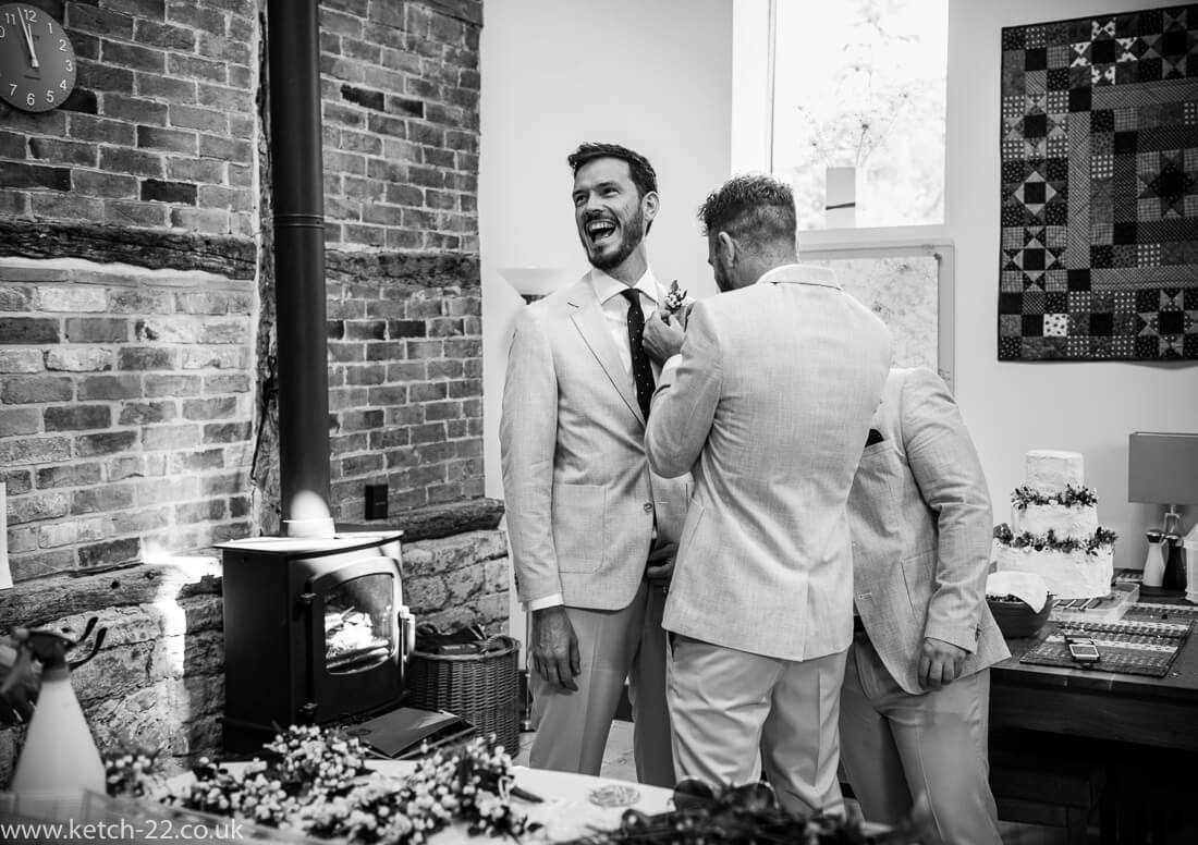 Laughing best man for Winchcombe wedding photography post
