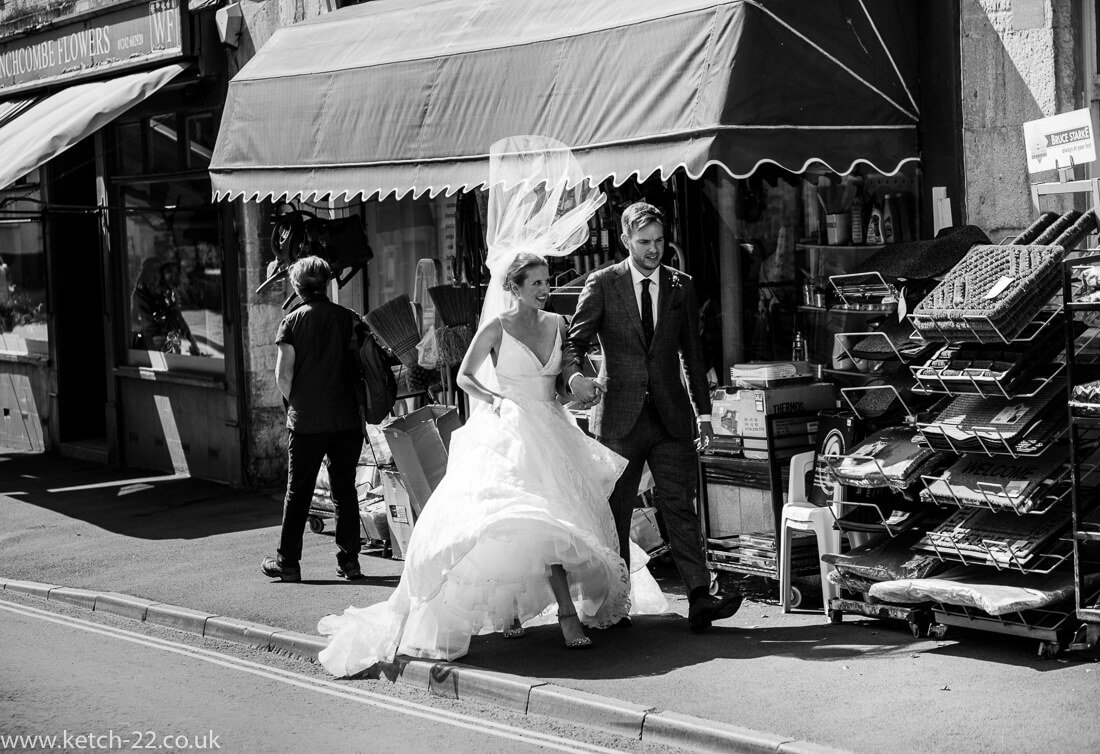 Brides veil is blown up by the wind