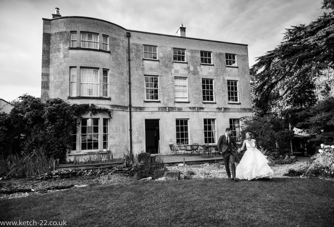 Natural wedding photo of bride and groom in black and white