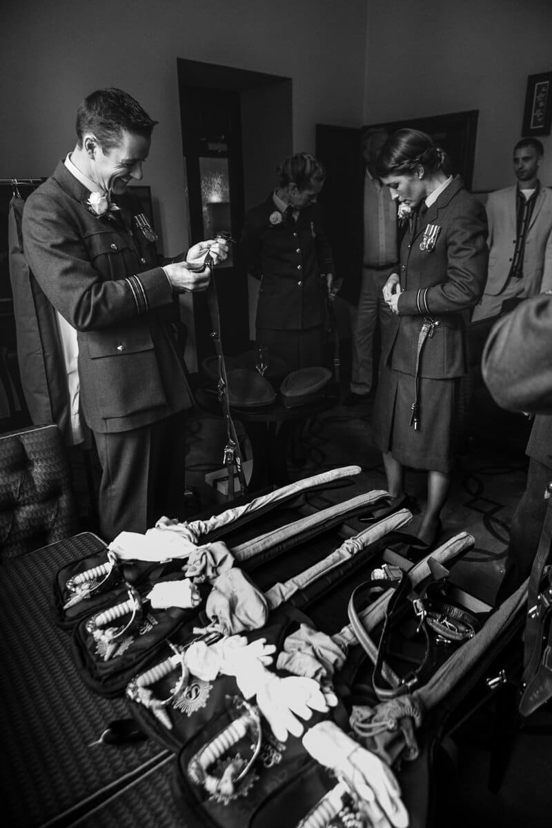 Display of RAF swords and members getting ready at wedding
