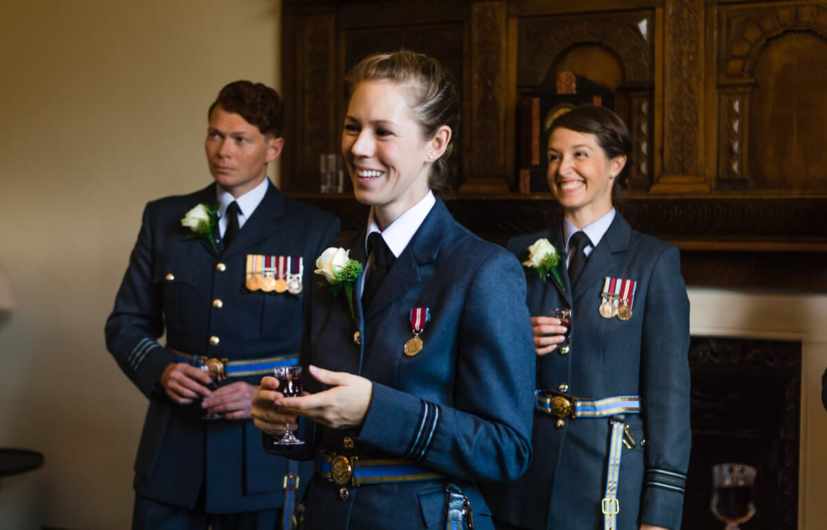 RAF girls relaxing with drink just prior to Country house wedding