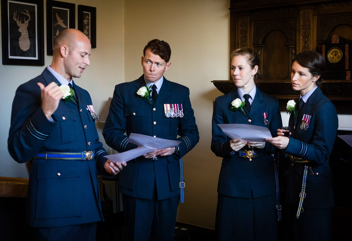 Groom in RAF uniform delivery wedding plan to his friends