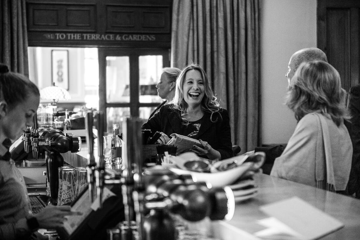 Guests relaxing in bar at De Vere Latimer Estate Wedding
