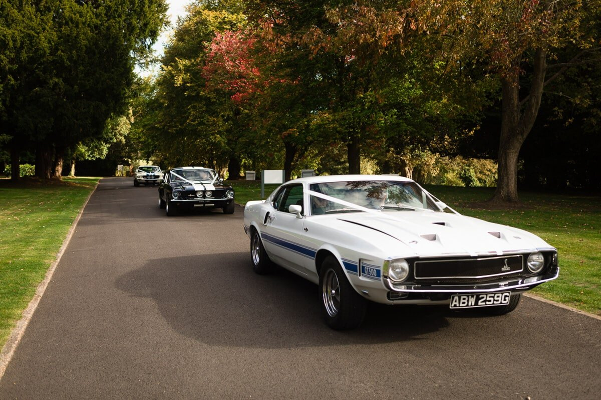 GT 500 American car arrives with bride at wedding