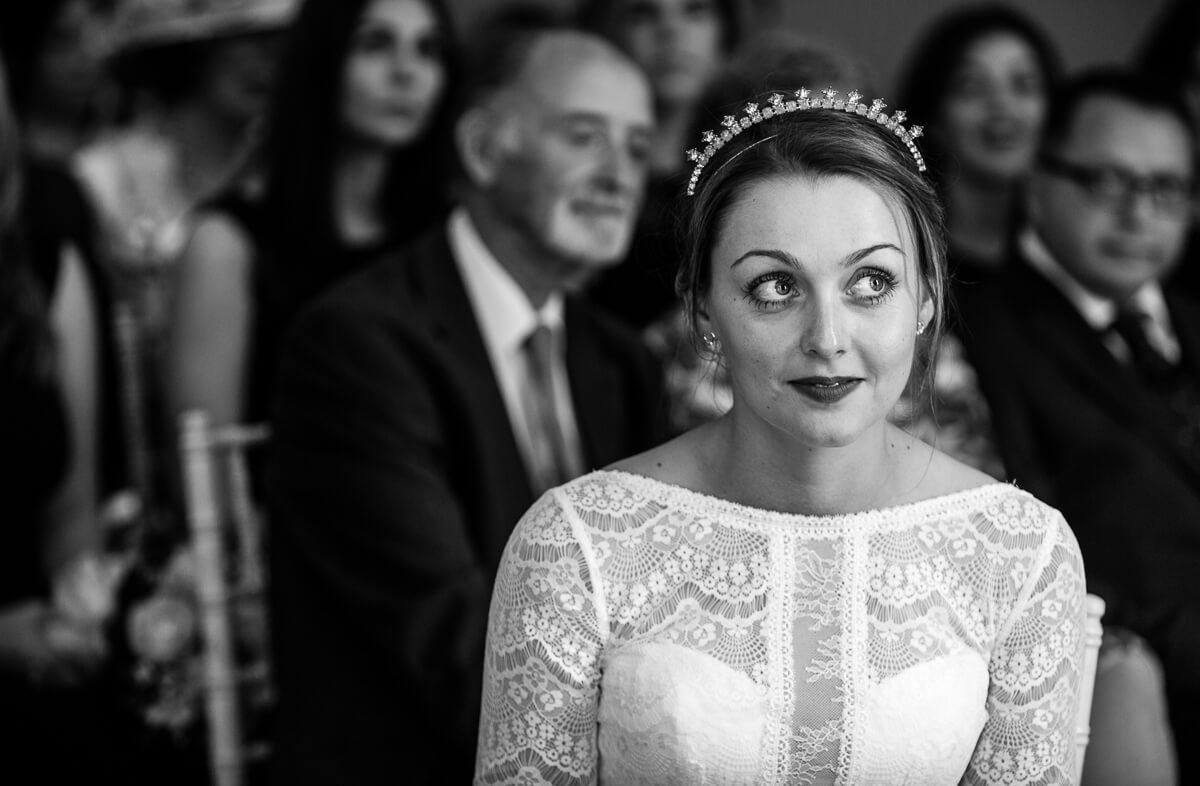 Bride looking at registrars during summer wedding ceremony