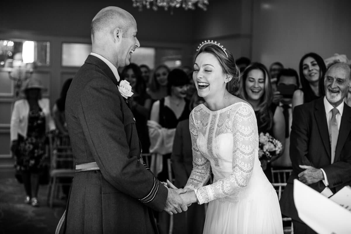 Bride and groom laughing at Country house wedding ceremony