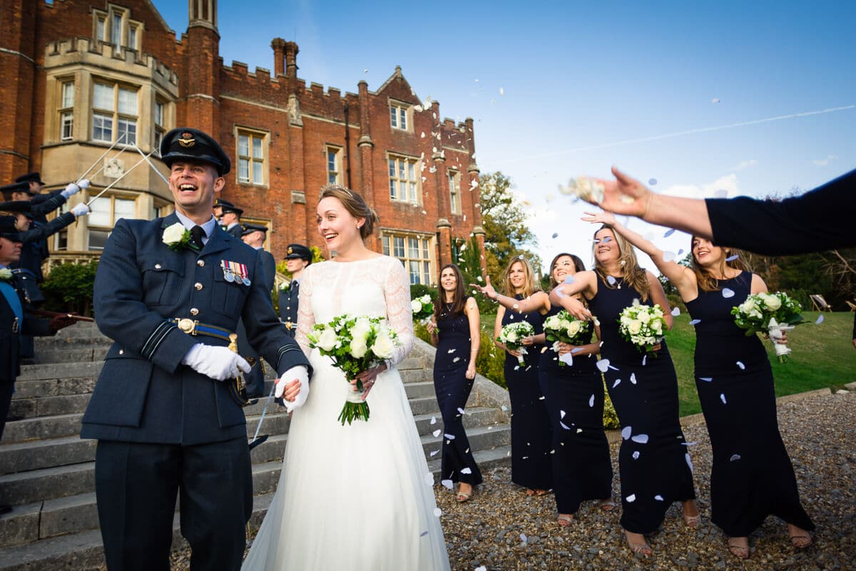 Bride and groom getting showered with confetti at De Vere Latimer Estate Wedding