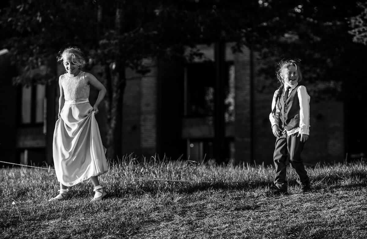 Reportage photo of kids playing at wedding