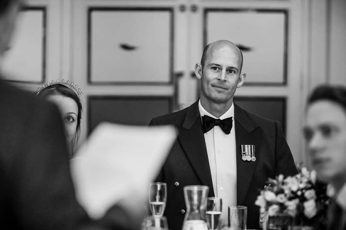 Groom listening to wedding speeches