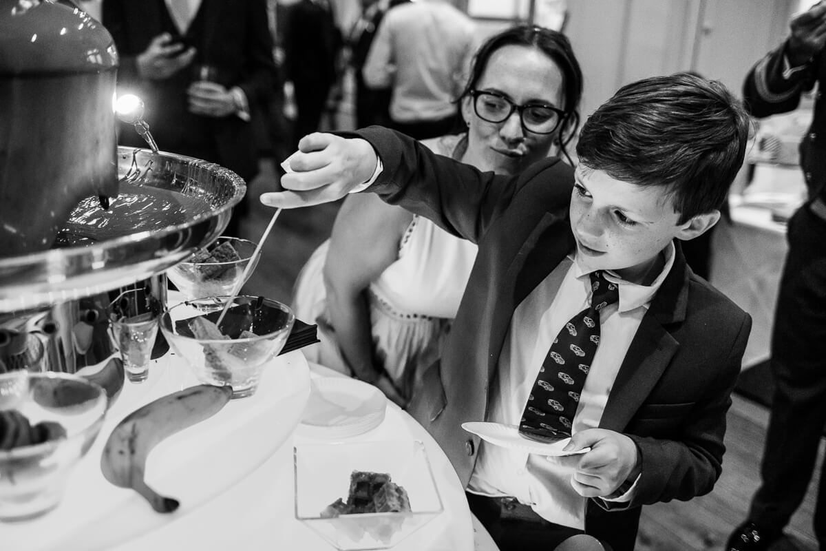 Little boy at chocolate fountain