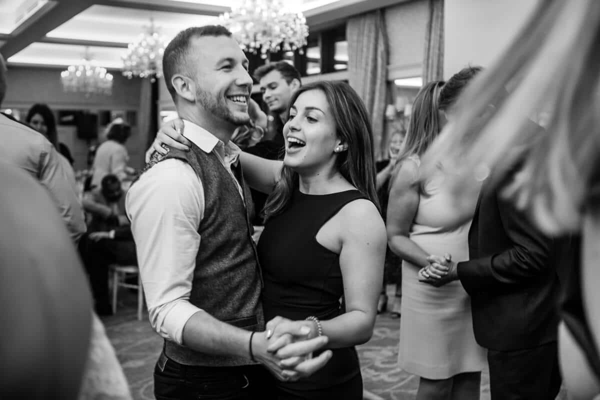 Natural fun wedding photo of guests dancing