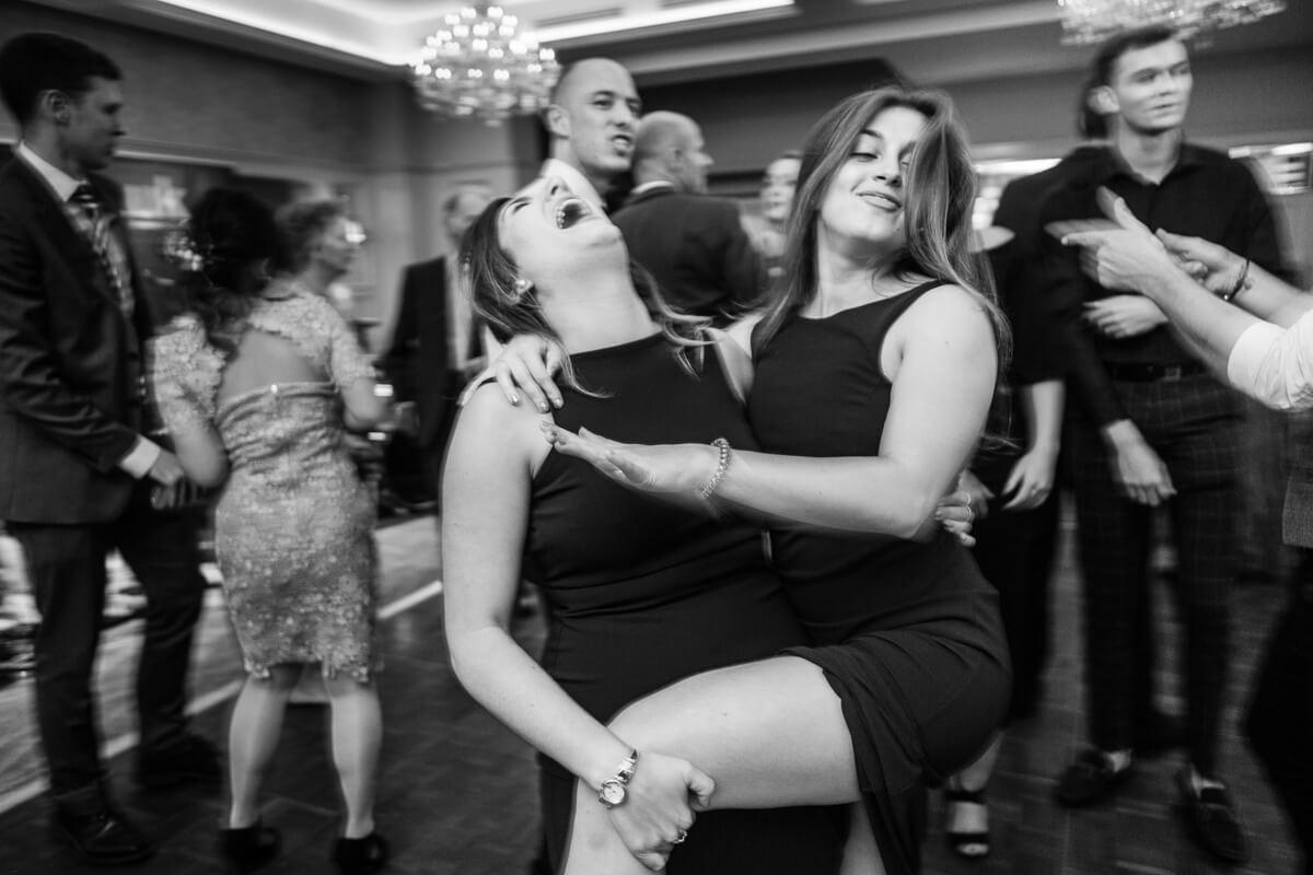 Bridesmaids going crazy on dance floor