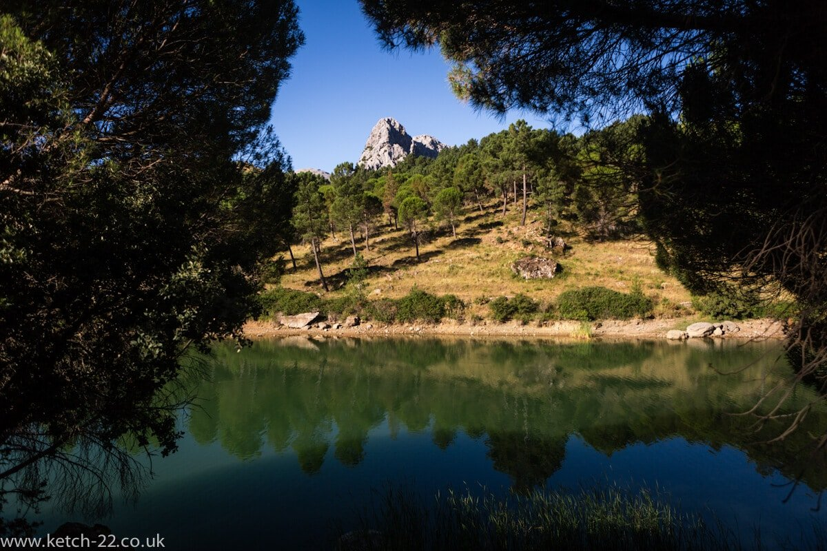 Green lake, green trees, mountain and blue sky's near Grazalema
