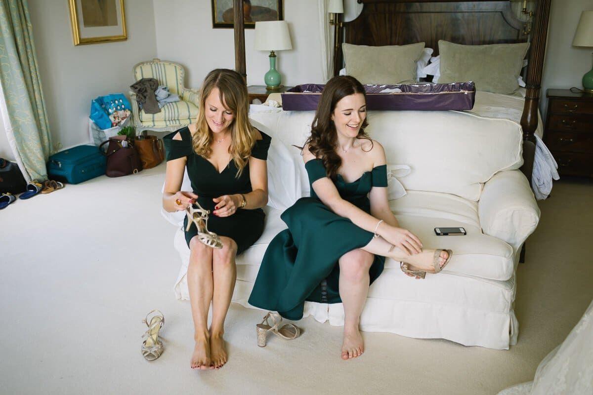 Bridesmaids putting on shoes