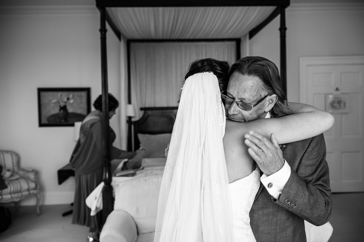 Father of bride gives his daughter a emotional hug