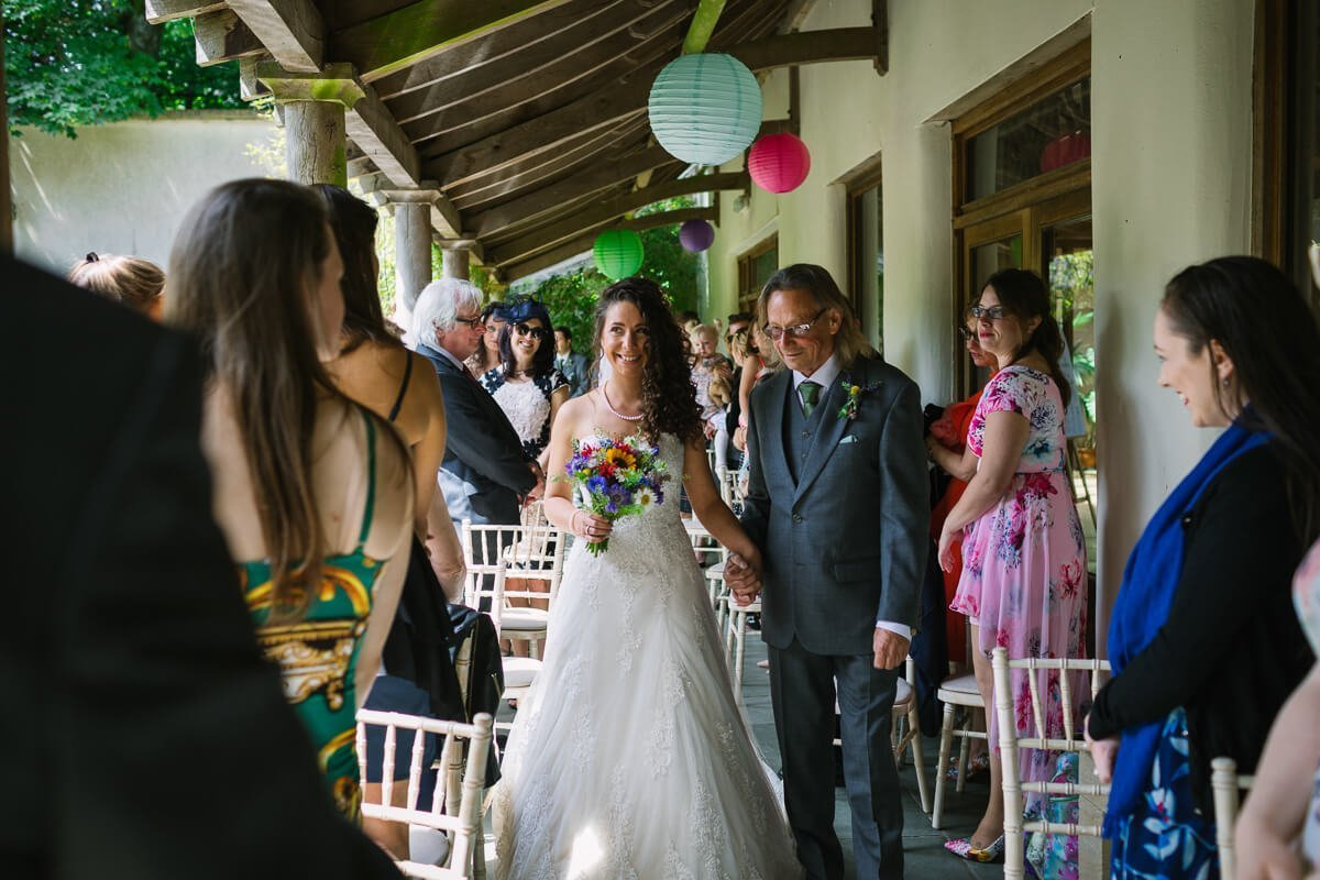Father of bride and daughter enter ceremony at Matara Centre Wedding