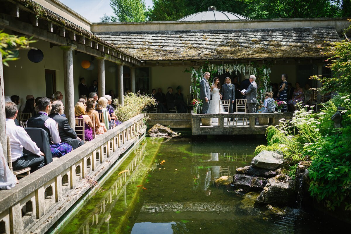 View of wedding ceremony over Japanese gardens