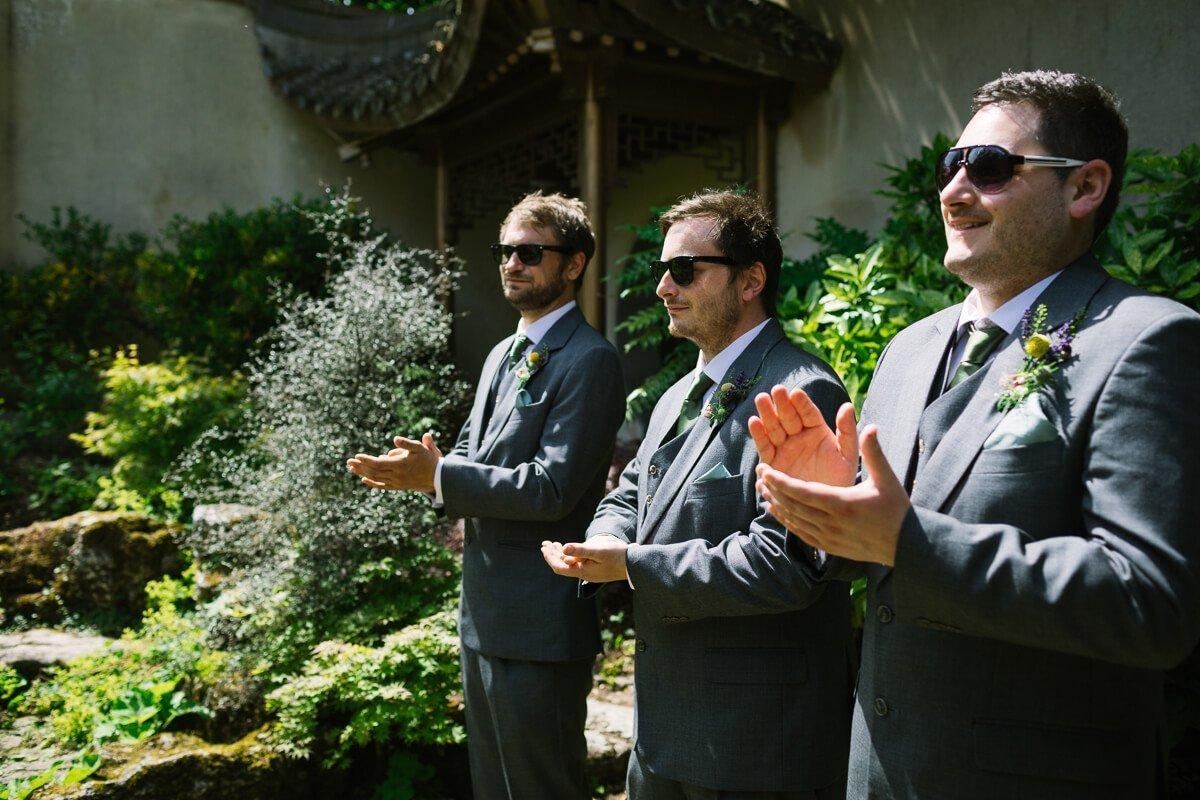 Groomsmen applauding at Wedding ceremony