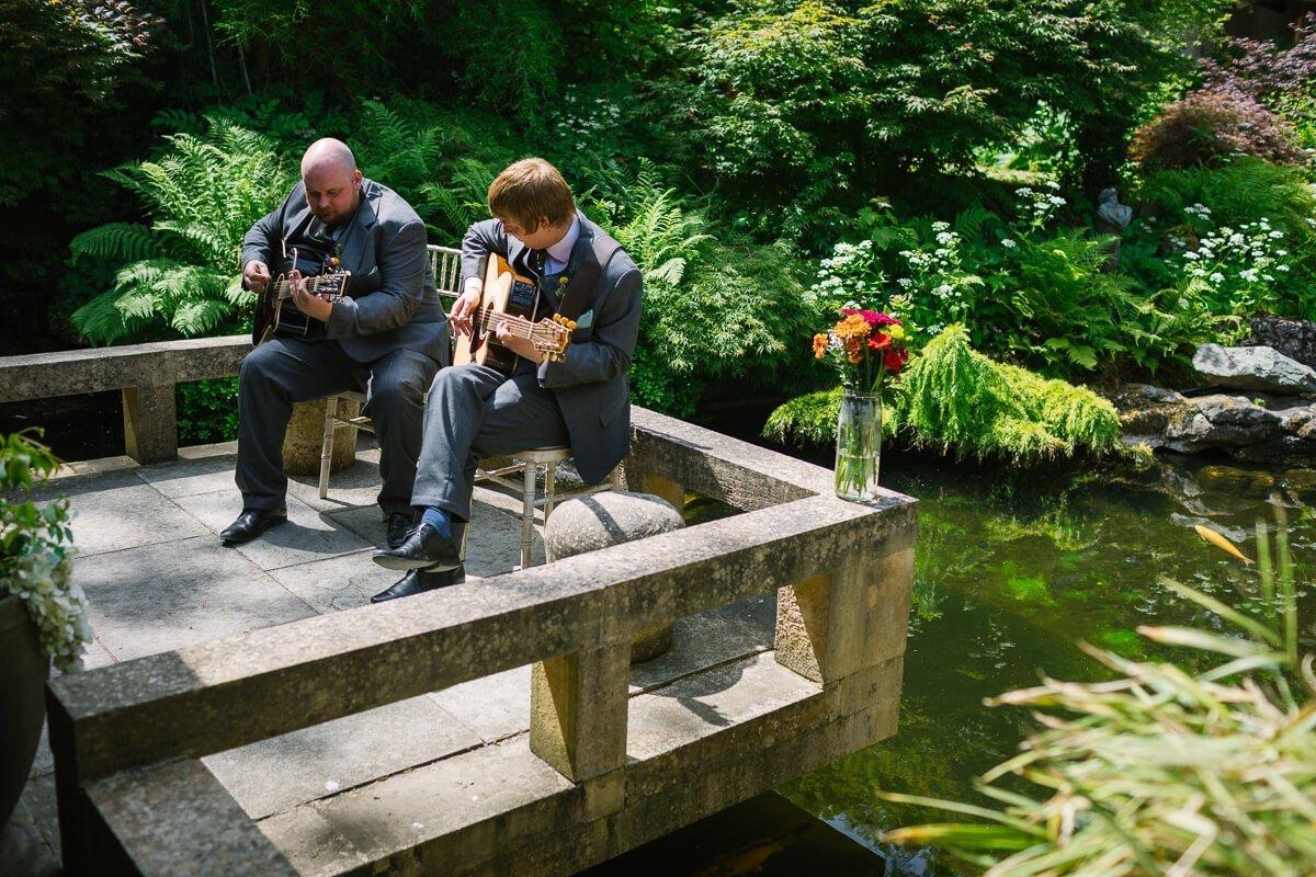 Groomsmen playing guitar at Matara centre wedding