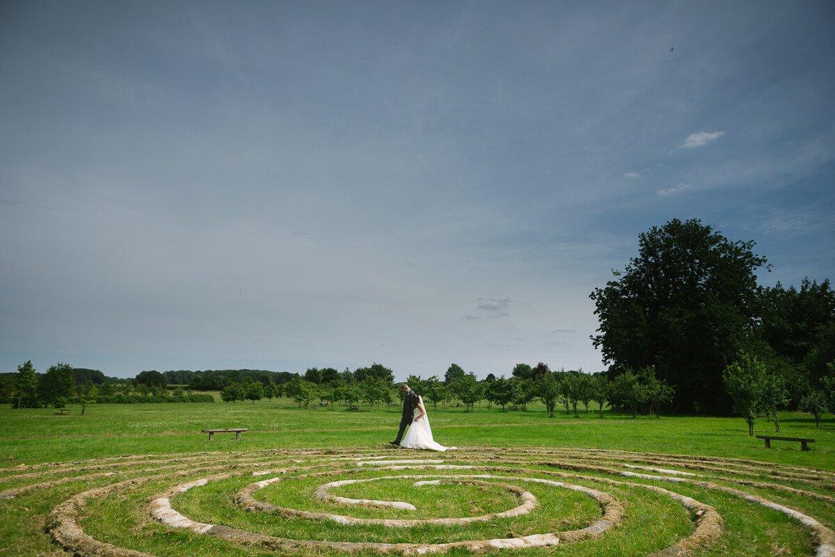 Bride and groom walking around spiral circle at Matara Centre Wedding