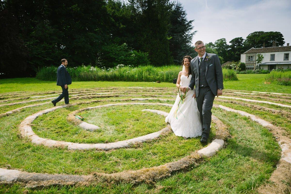 Newly weds walking around spiral circle at Matara Centre