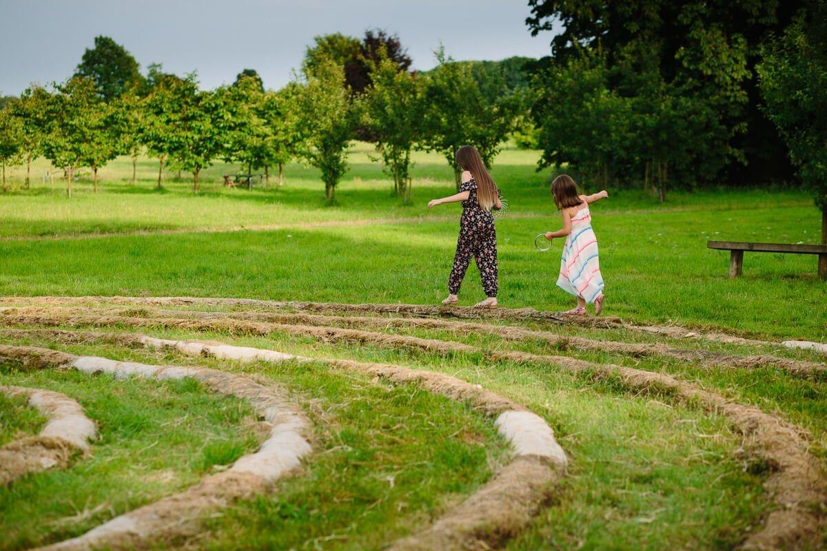 Kids playing in gardens at wedding