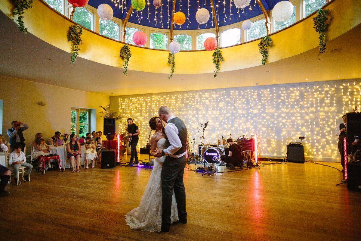 Bride and groom enjoy first dance at wedding reception