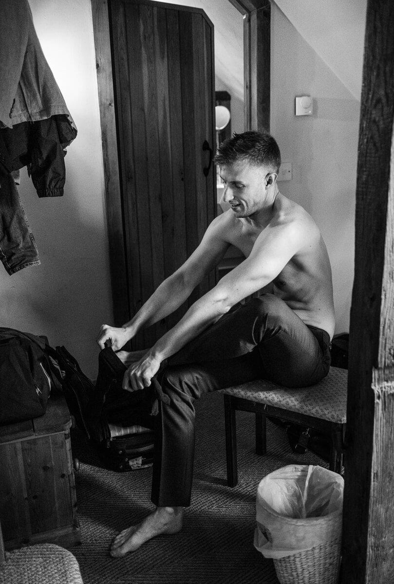 Groom getting ready at Cripps Barn