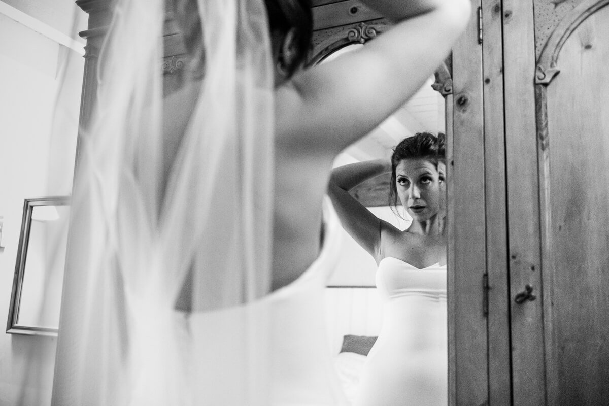 Bride looking in mirror for the last time before Wedding ceremony