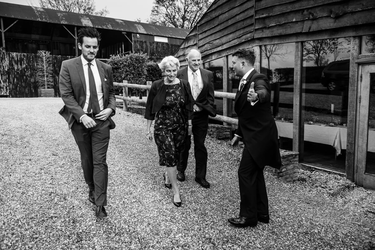 Wedding guests arriving at Cripps Barn