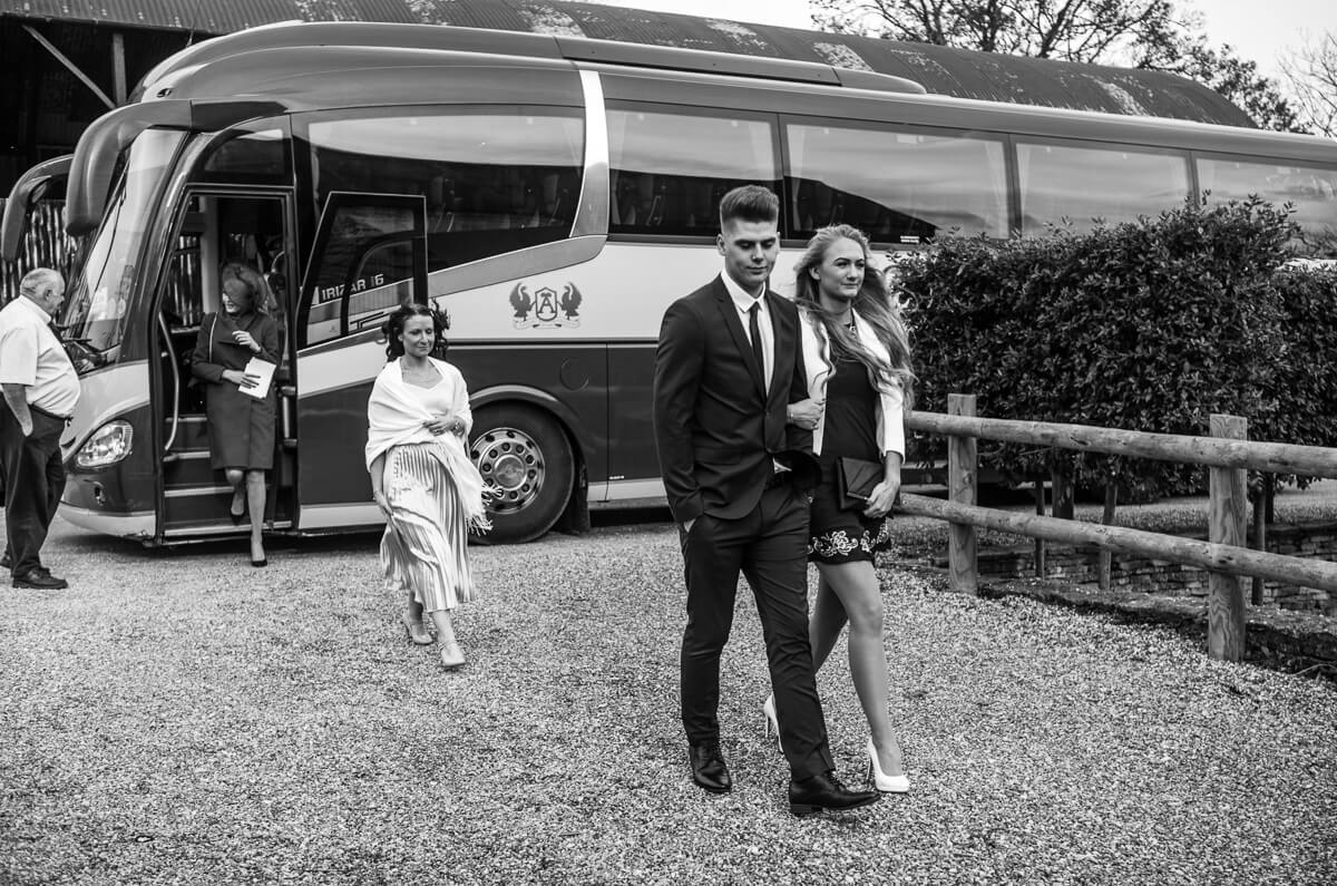 Wedding guests getting off coach