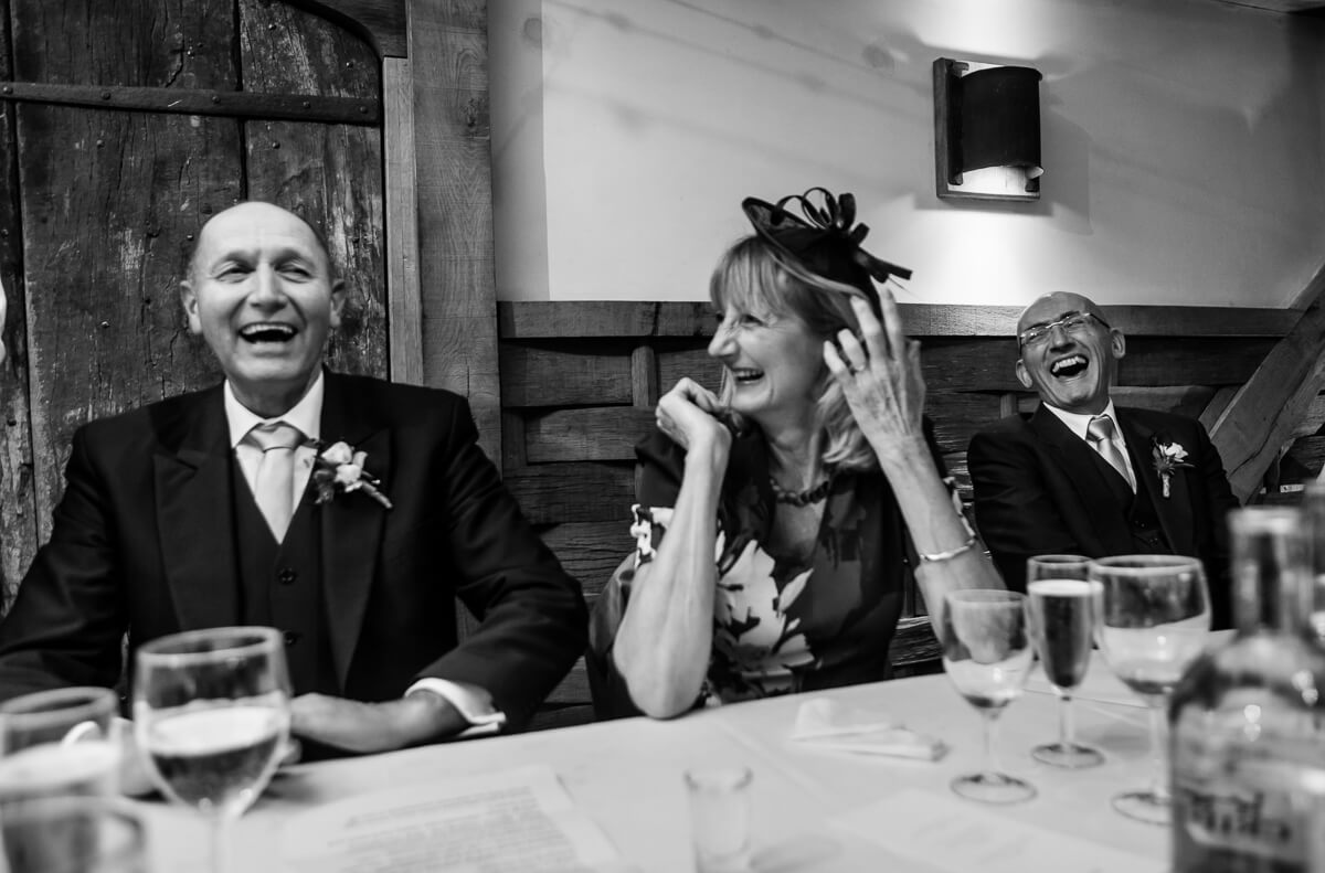 Dad laughing at wedding speeches