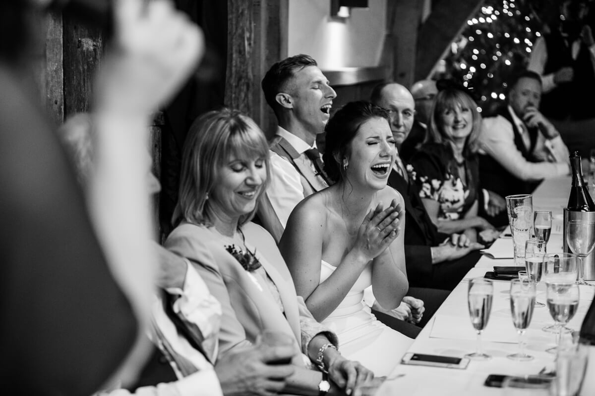 Bride reacting to wedding speeches