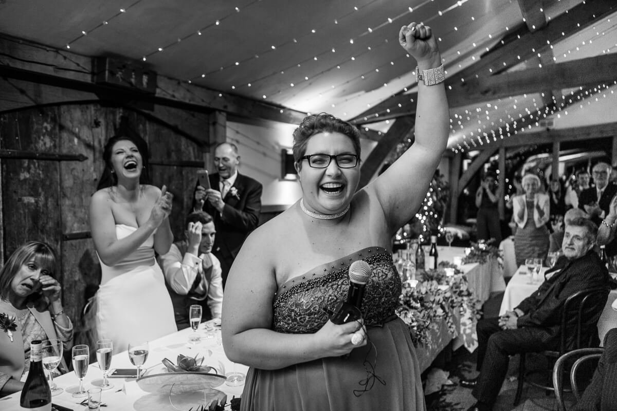 Brides sister thumps the air as she finishes speech