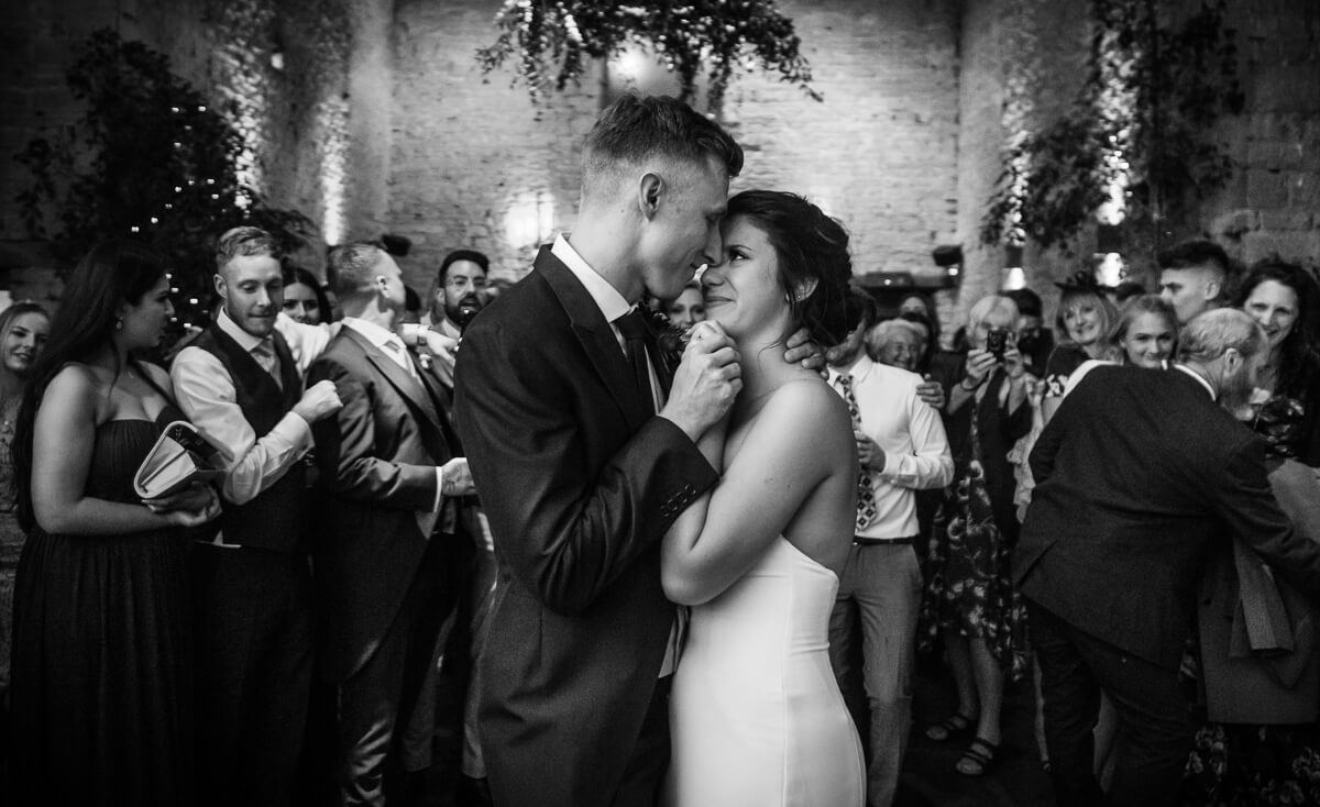 Black and white photo of bride and groom enjoying first dance