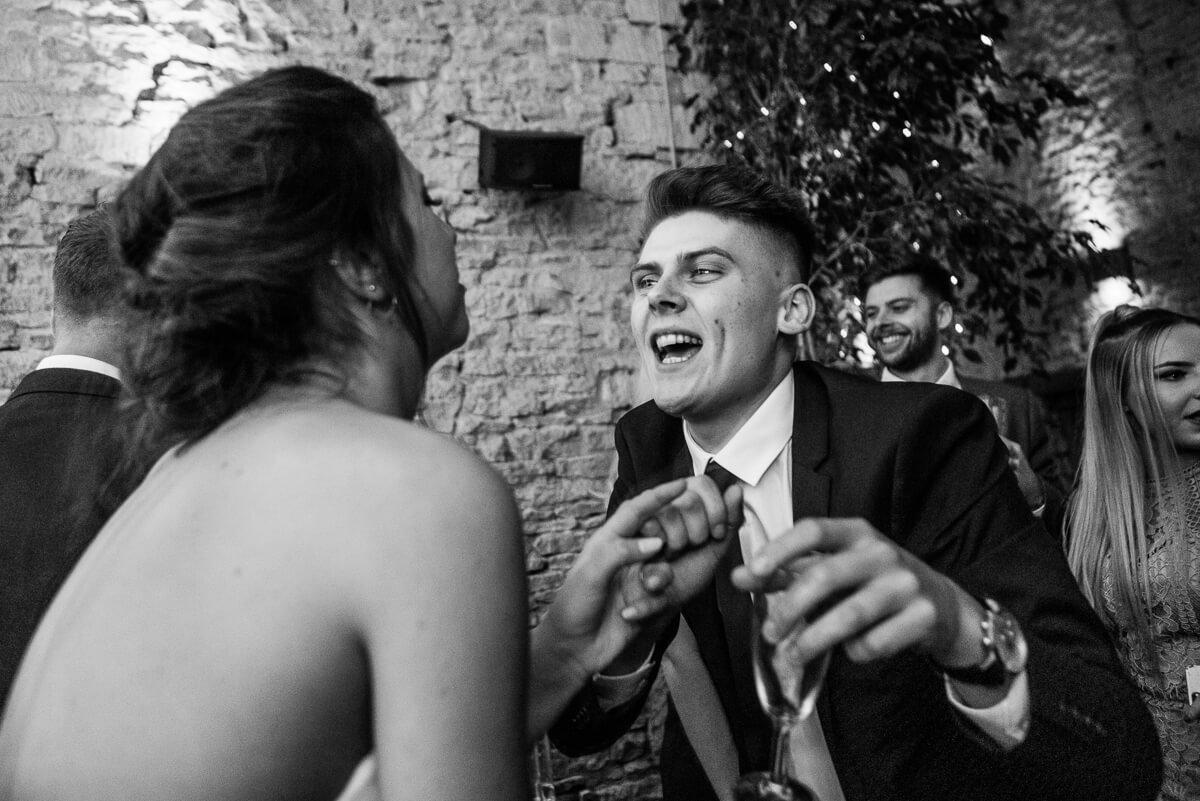 Wedding guest dancing with bride