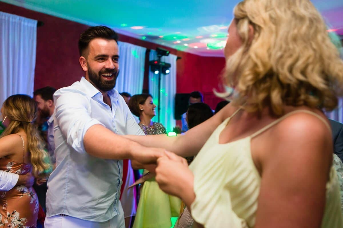 Wedding guests dancing at reception