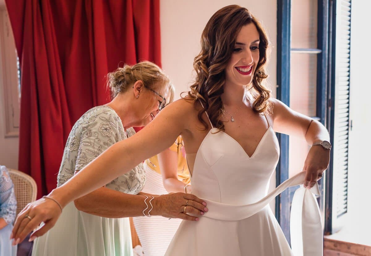 Mother applies final touches to Wedding dress