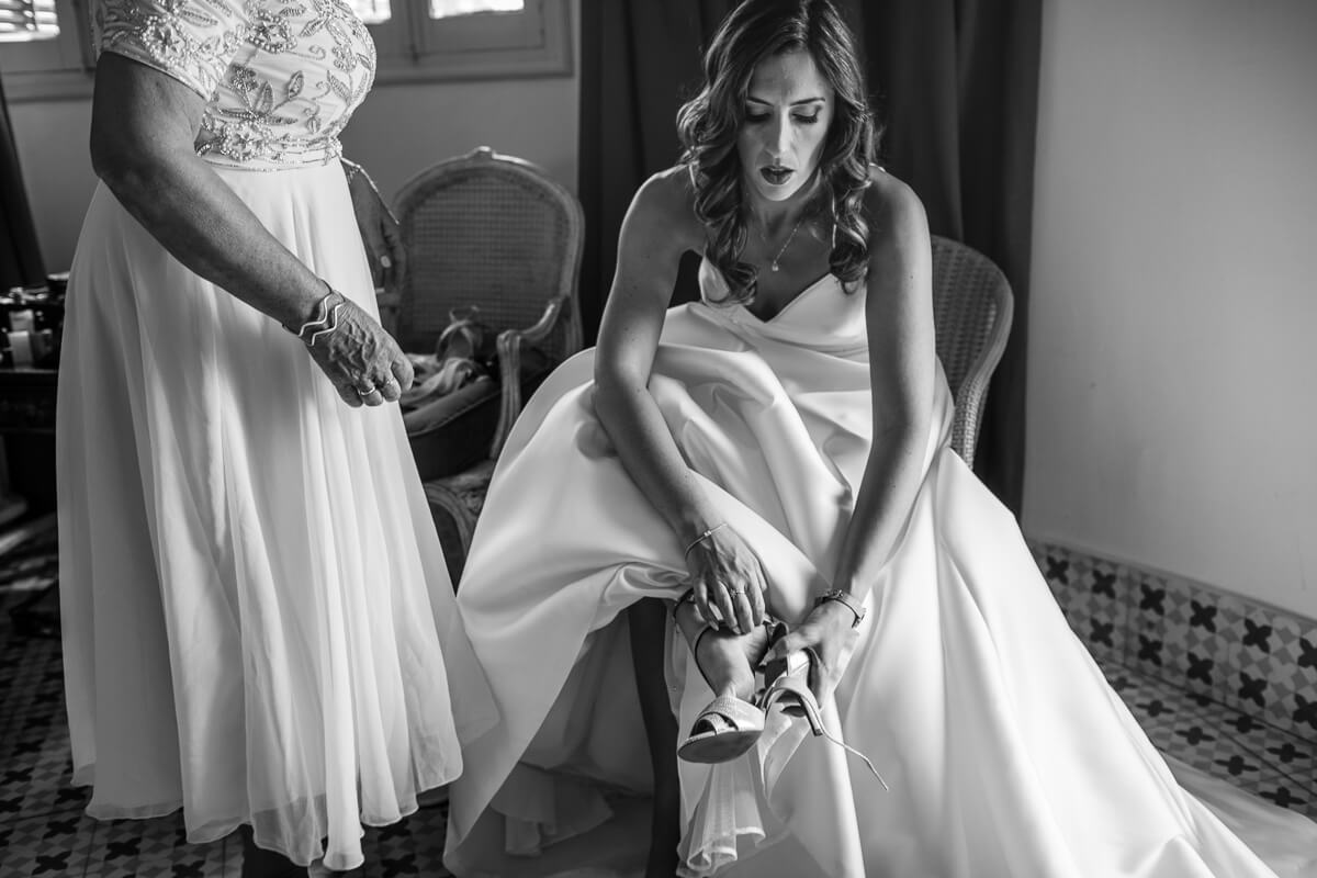 Bride putting on her shoes at Wedding in Malaga Spain