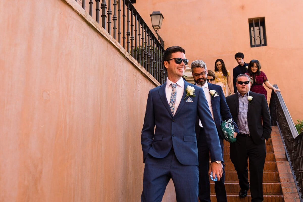 Groom and wedding party walking down steps