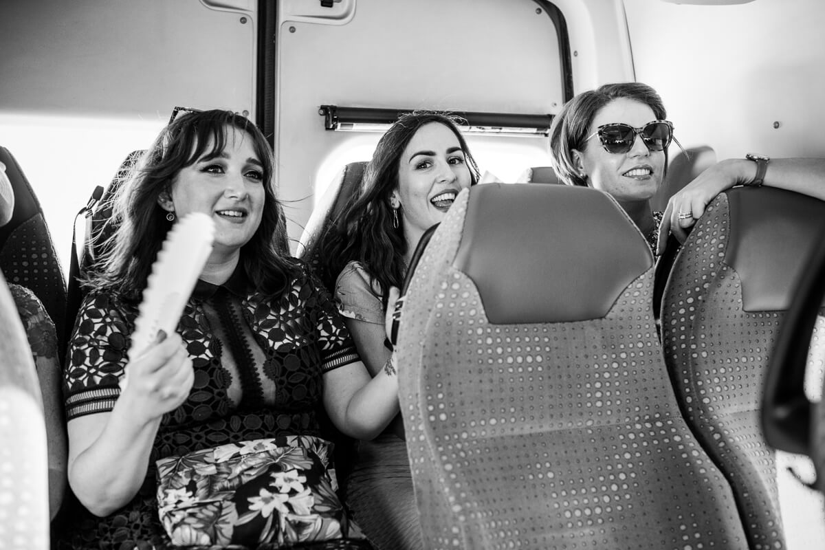 Bridesmaids in the back of mini bus at Malaga Wedding