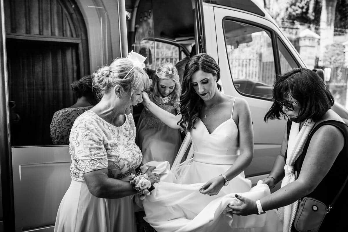 Bride arriving on mini bus to wedding