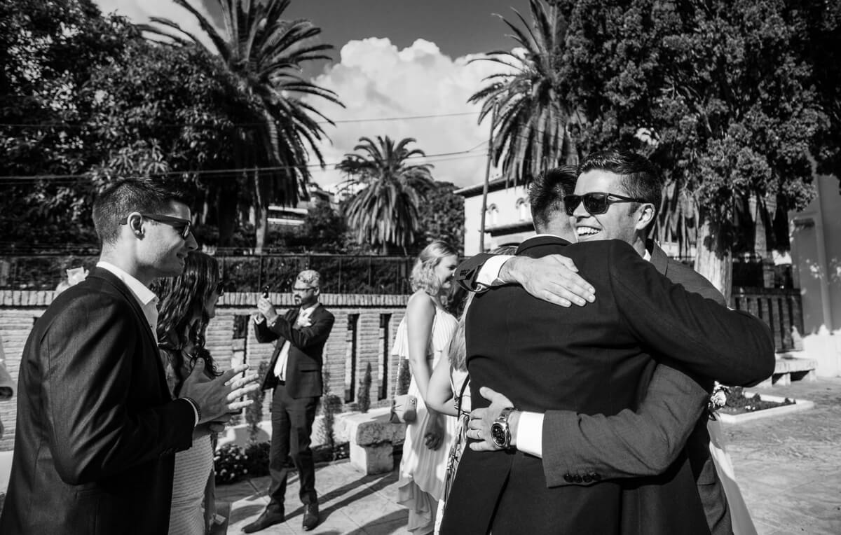 Groom greeting guests at wedding in Malaga Spain
